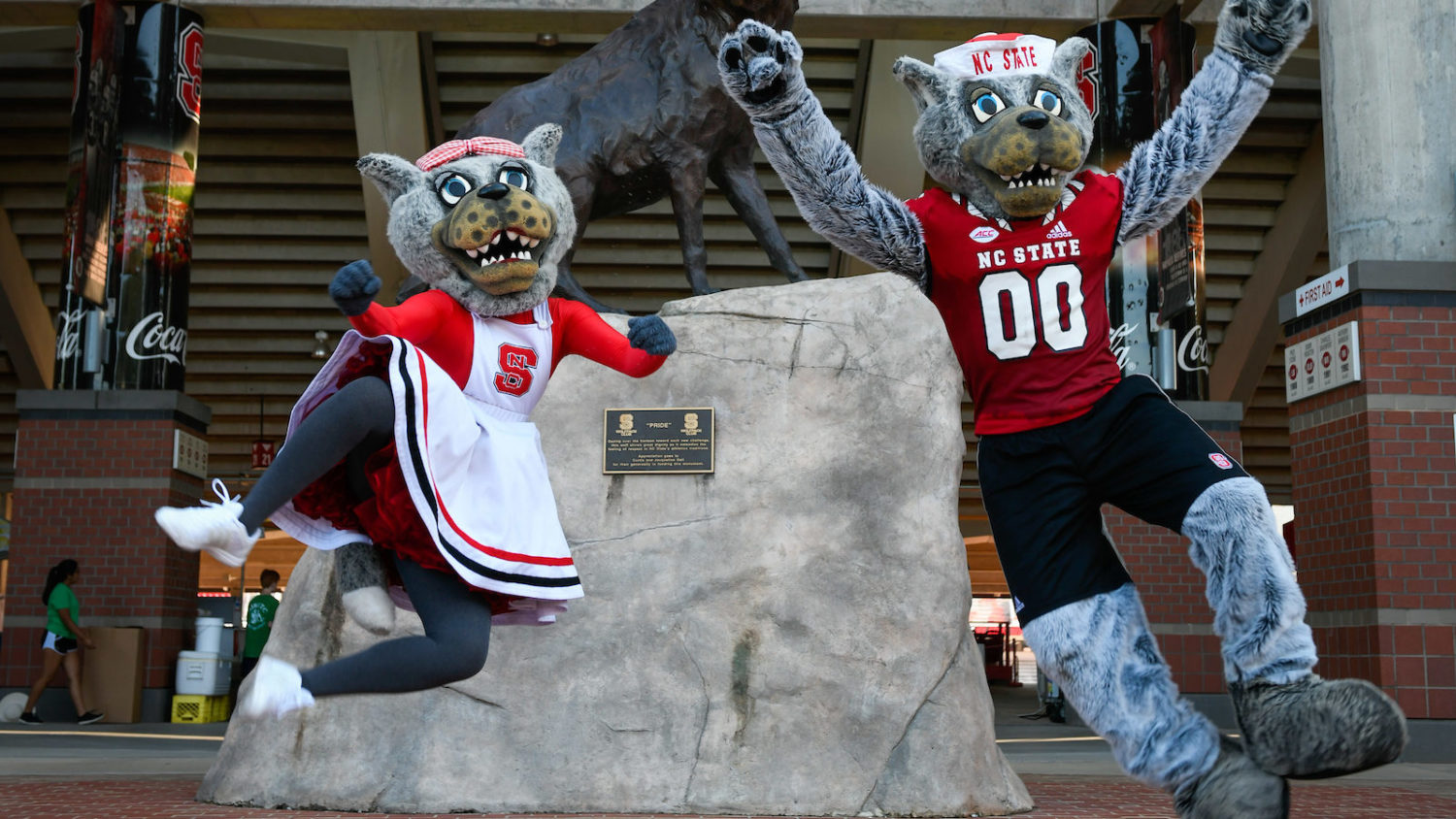 Mr. and Ms. Wuf jump in celebration outside Carter Finley stadium
